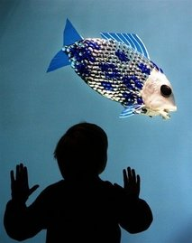 Source: AFP/File – A child looks at a robotic fish developed by the researchers at the University Essex, 2005.