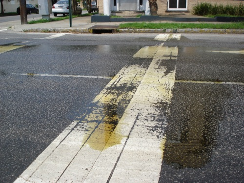 An unidentified spill covers Ashley Avenue in Downtown Charleston.  Photo by: Andy Lassiter