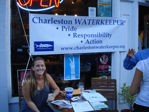 Charleston Waterkeeper intern, Alessandra Castillo, manning the table at Queen Street Grocery's wine tasting